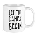 Let the Games Begin (blk text) Mugs