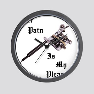 Your pain is my pleasure Wall Clock