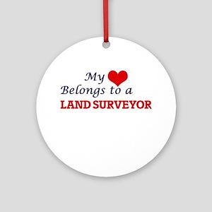 My heart belongs to a Land Surveyor Round Ornament