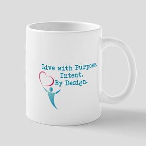 Living by Design Slogan Mugs