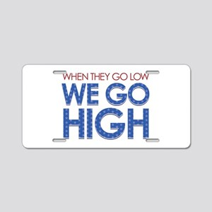 They Go Low, We Go High Aluminum License Plate