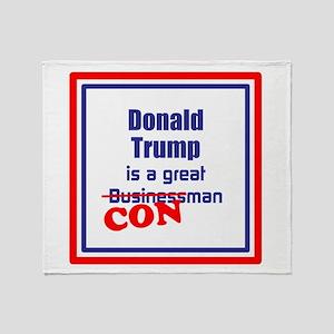 Trump is a con man Throw Blanket