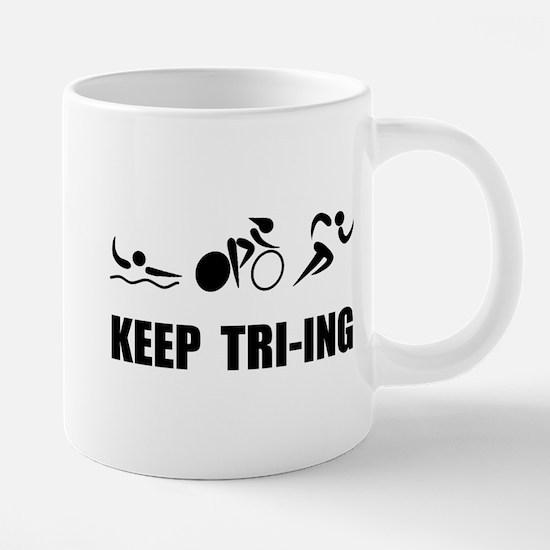 KEEP TRI-ING Mugs