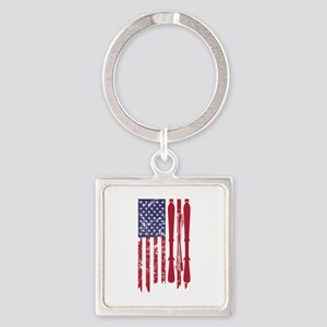 US flag with skis and ski poles as strip Keychains