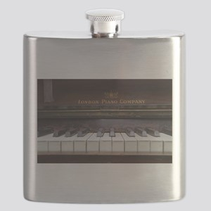 Piano keys on Old antique vintage music inst Flask