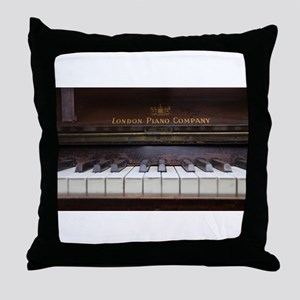 Piano keys on Old antique vintage mus Throw Pillow