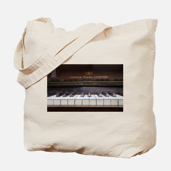 Piano keys on Old antique vintage music i Tote Bag