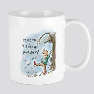 Boy Playing In The Autumn Leaves Mugs