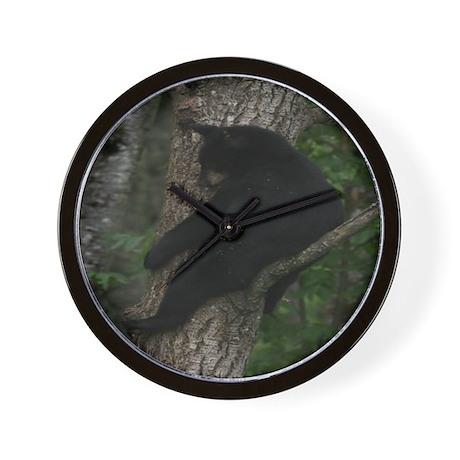 black bear in tree Wall Clock