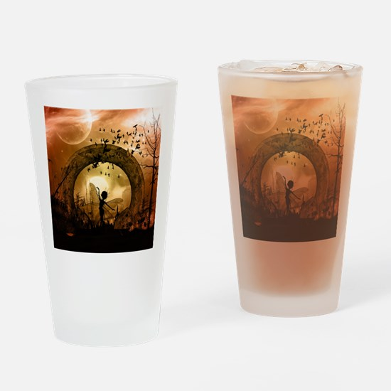 Cute dancing fairy in the sunset Drinking Glass