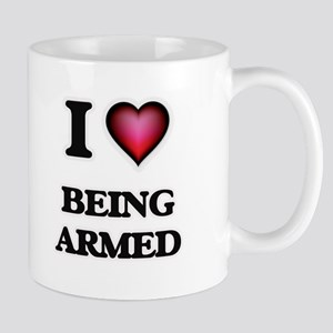 I Love Being Armed Mugs