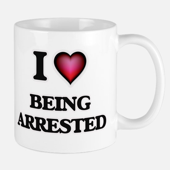 I Love Being Arrested Mugs
