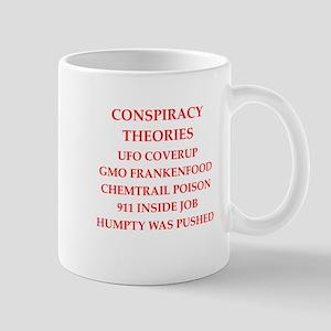 conspiracy theories Mugs