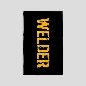 Welding: Stencil Welder (Black & Gold) Area Rug