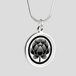 Lotus bloom in circle Necklaces