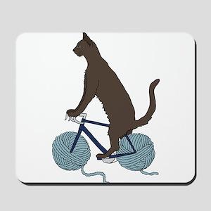 Cat Riding Bike With Yarn Ball Wheels Mousepad