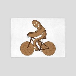 Gingerbread Man Riding Bike With Gi 5'x7'Area Rug