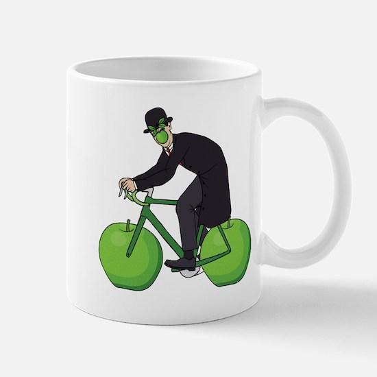 Son Of Man Riding Bike With Apple Wheels Mugs
