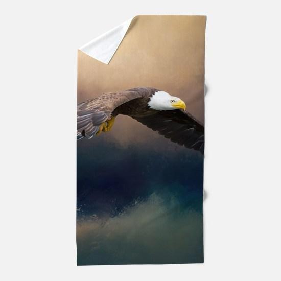 Flying american bald eagle Beach Towel