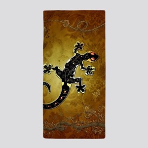 Gecko in red and gold Beach Towel