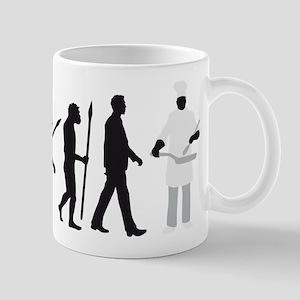 Evolution of man chief cook Mugs