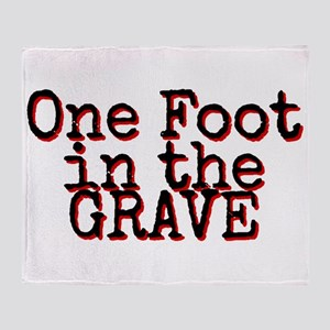 One foot in the Grave Throw Blanket