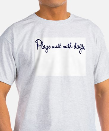 Plays well with dogs -  T-Shirt