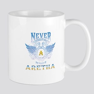 Never underestimate the power of aretha Mugs