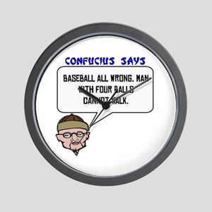 Man with four balls Wall Clock