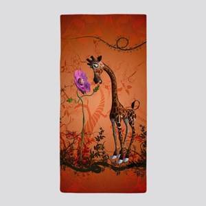 Funny giraffe with flower Beach Towel