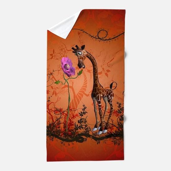 Funny giraffe with flower Beach Towel