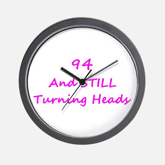 94 Still Turning Heads 1C Pink Wall Clock