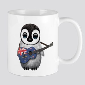 Baby Penguin Playing New Zealand Flag Guitar Mugs