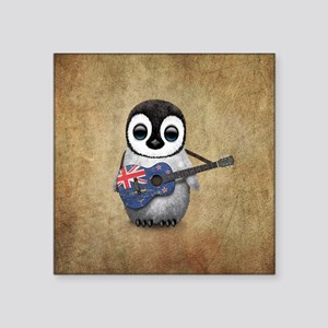 Baby Penguin Playing New Zealand Flag Guitar Stick