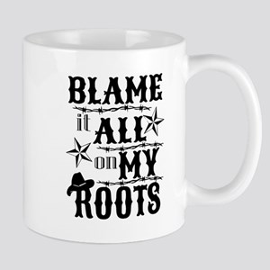 blame it on my roots Mugs