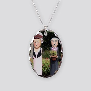 Old married couple sculptures Necklace Oval Charm