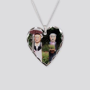Old married couple sculptures Necklace Heart Charm
