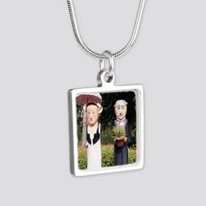 Old married couple sculptures Necklaces
