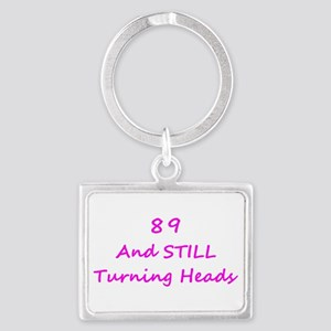 89 Still Turning Heads 1C Pink Keychains