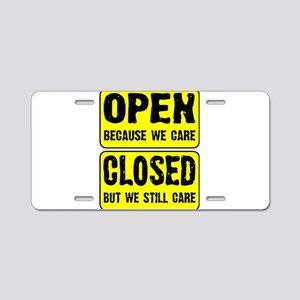 Open and Closed Aluminum License Plate