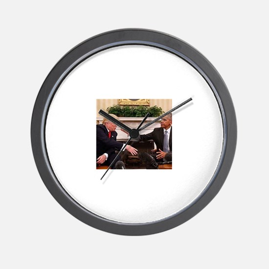 barack obama giving donald trump the mi Wall Clock