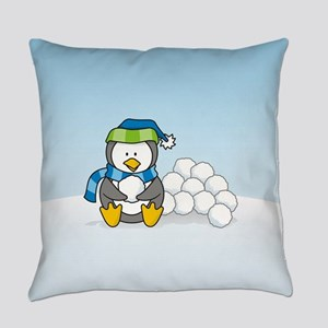 Little penguin sitting with snowballs on snow Ever