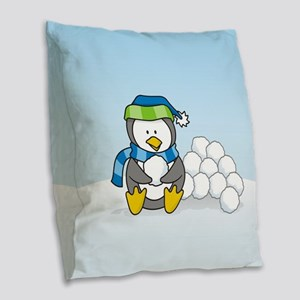 Little penguin sitting with snowballs on snow Burl