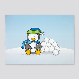 Little penguin sitting with snowballs on snow 5'x7