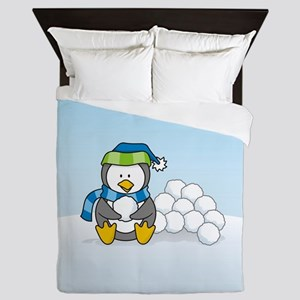 Little penguin sitting with snowballs on snow Quee