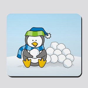 Little penguin sitting with snowballs on snow Mous