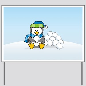 Little penguin sitting with snowballs on snow Yard