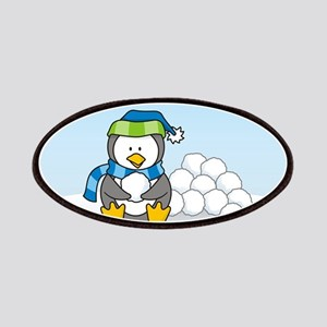 Little penguin sitting with snowballs on snow Patc