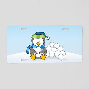 Little penguin sitting with snowballs on snow Alum