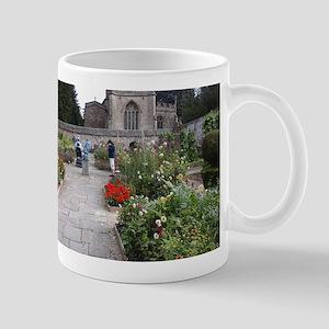 Avebury manor courtyard Mugs